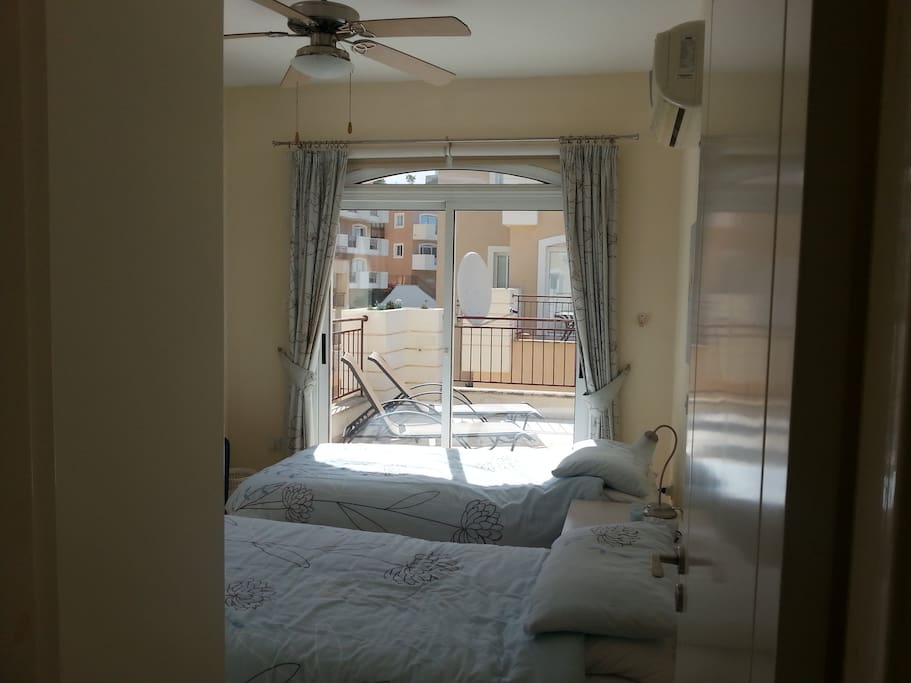 Second bedroom leading to large terrace
