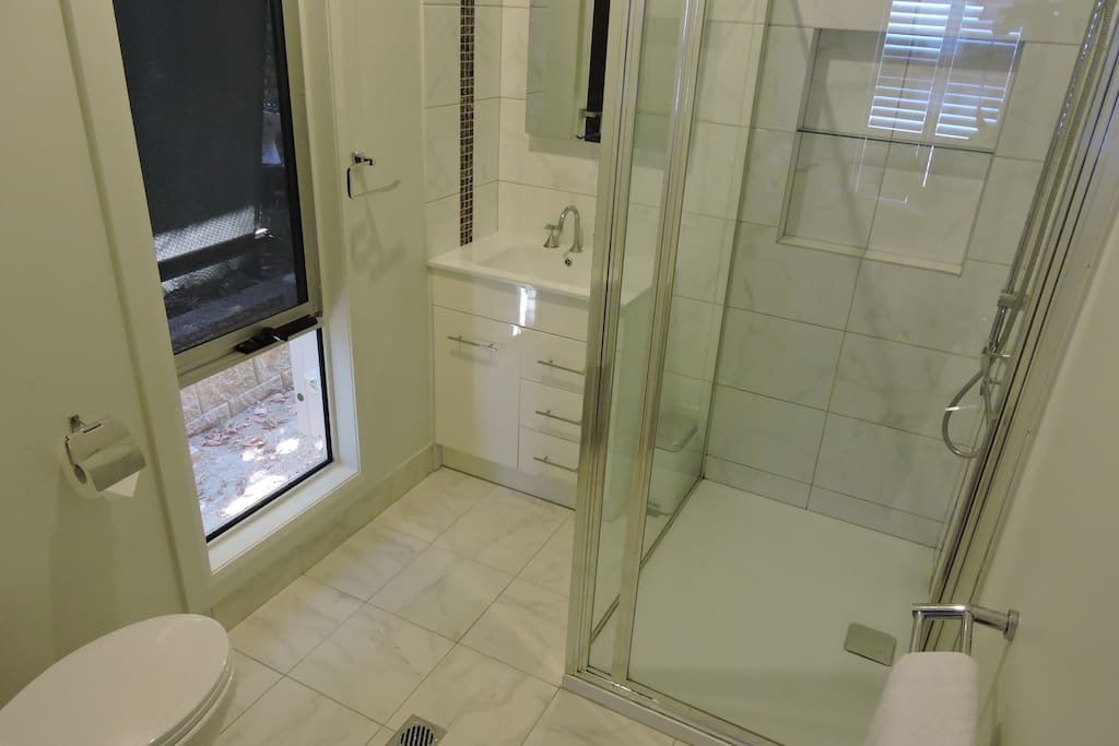 The En-suite has a roomy shower and vanity as well as a toilet.
