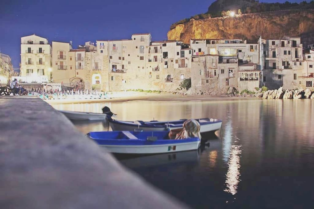 the small port of Cefalù with typical Sicilian fishermen's boats