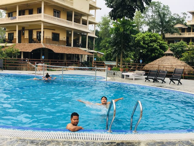 Guest enjoying at newly constructed swimming pool