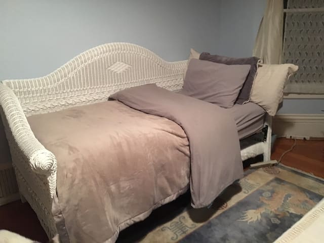 Classic Victorian Elegance w Luxurious Linens as a twin size bed for more room space.