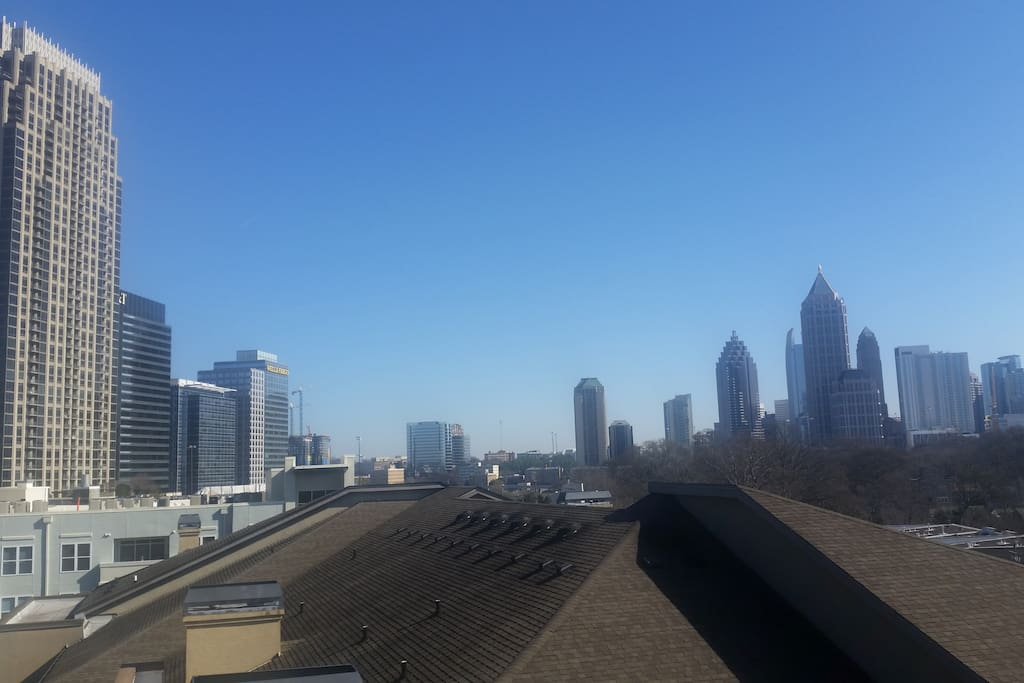 View of Atlantic Station/Midtown from assigned deck parking space included in your stay
