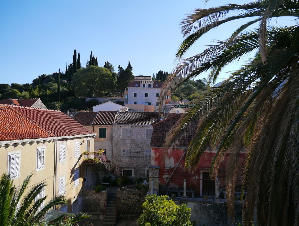 Stunning rooftop views over the charming old town to the hilltop churches of Sveti Rocka and Sveti Nikola.