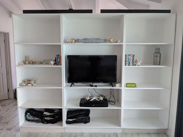 Sept 2019: Media wall w/ extra storage, TV and Blu-ray player.