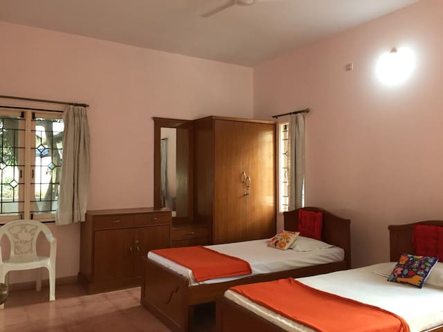 Enjoy the aroma of Mango garden during Mango flowering season. Feel  a cool  comfort with airy and well  Sun lit spacious room.