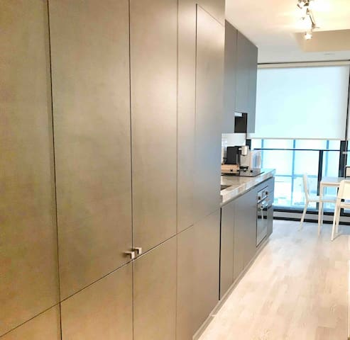 Scavolini kitchen: builtin cabinetry, hidden fridge. Well appointed.