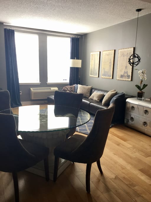 Living are with generously sized leather seating and dining table with seating for 4