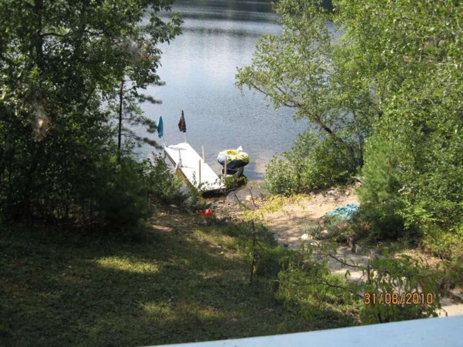 View of beach area and lake from deck