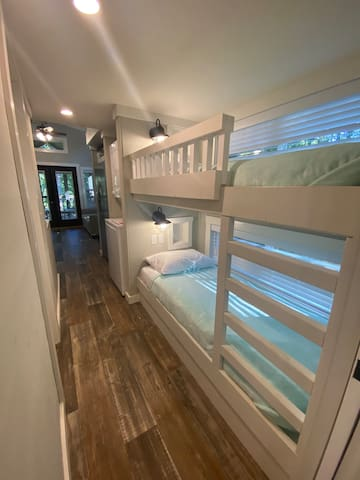 Bunks in the Hall with sconce lights and cubbies.