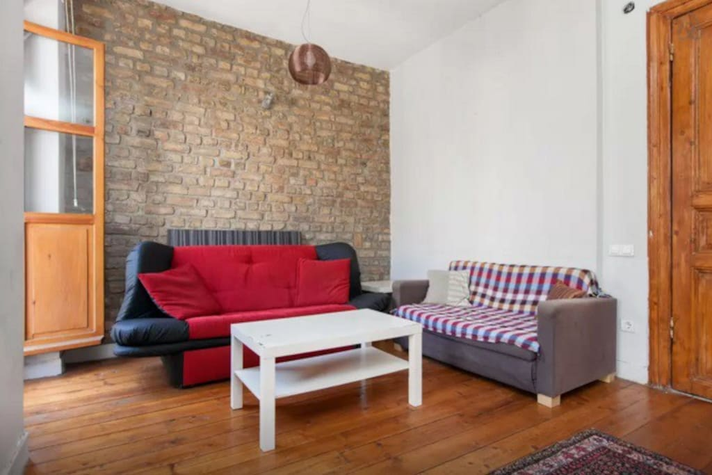 Comfy sofas with the original firebrick background