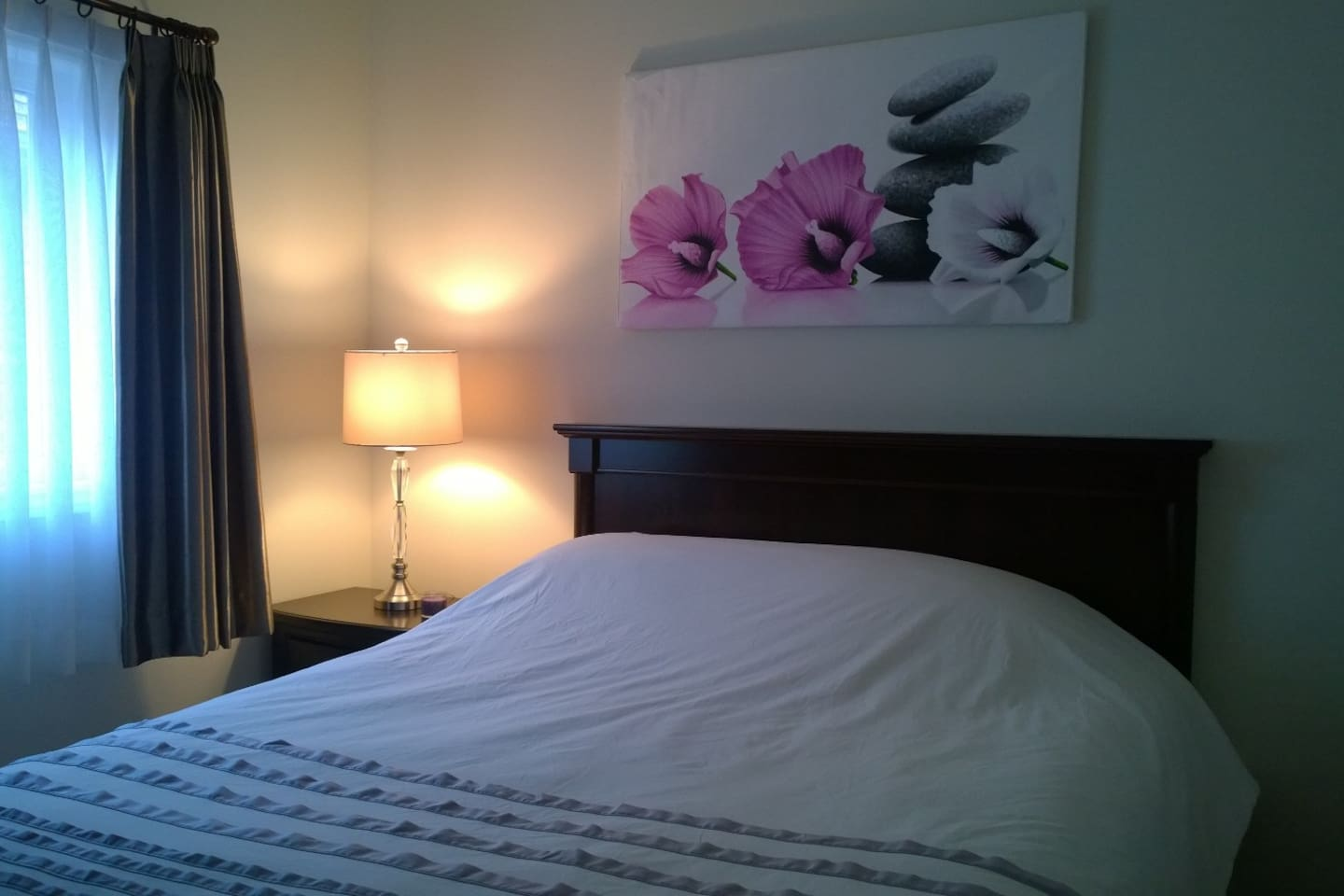 The purple and white bedroom with private bedroom