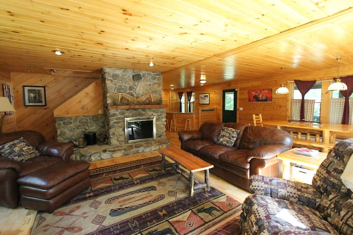 Relax by the wood burning fireplace in the living room