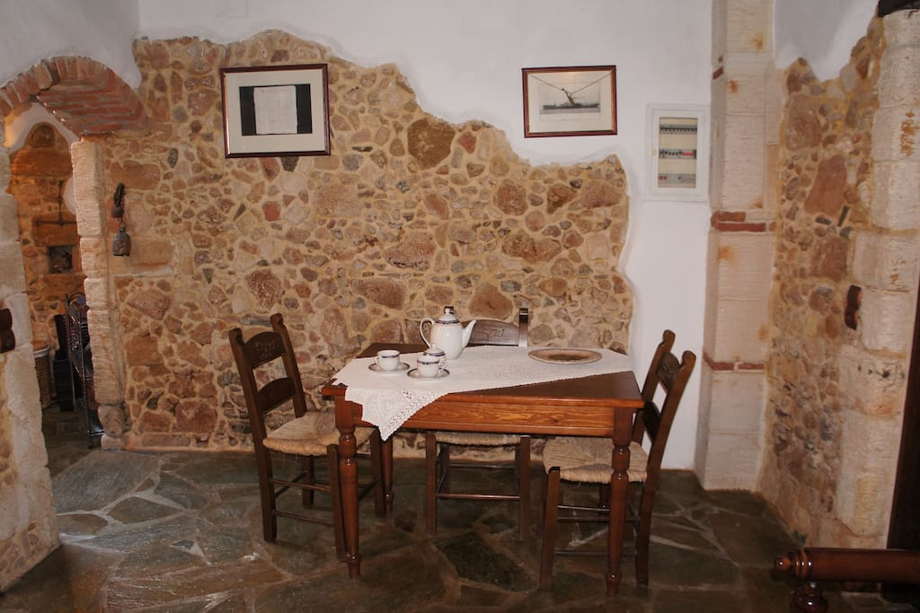 Traditional Dining area, wood table and chairs that can accommodate six people.