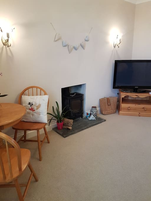 The Living area, with dining table & log burner, logs provided! Beautiful view, light & airy.