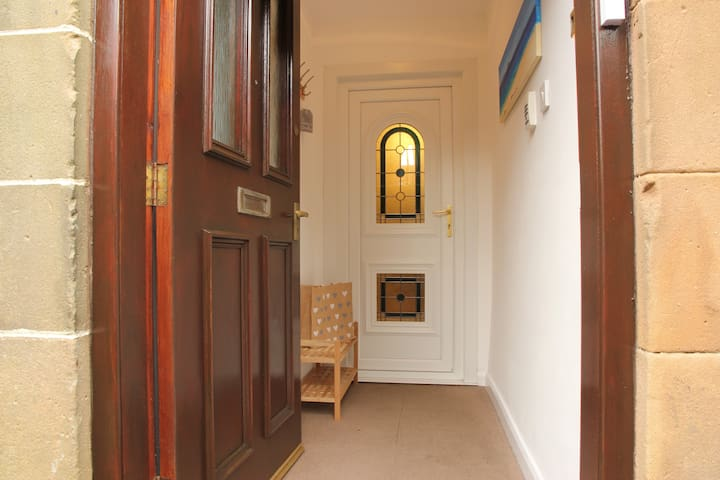 entrance porch, kick your shoes off, hang up your coat