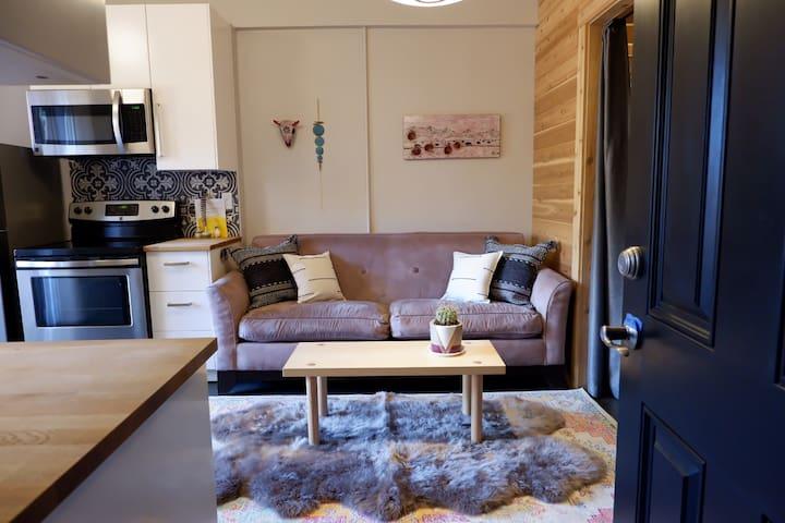 Studio living space.  Sheepskin rug has been removed.
