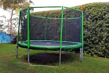 Big secure back garden with trampoline for the kids