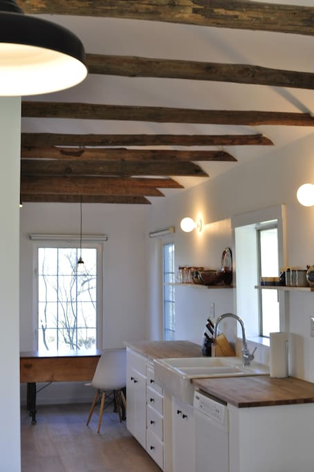 Original 100 year old exposed beams that flow from the living room to the kitchen.