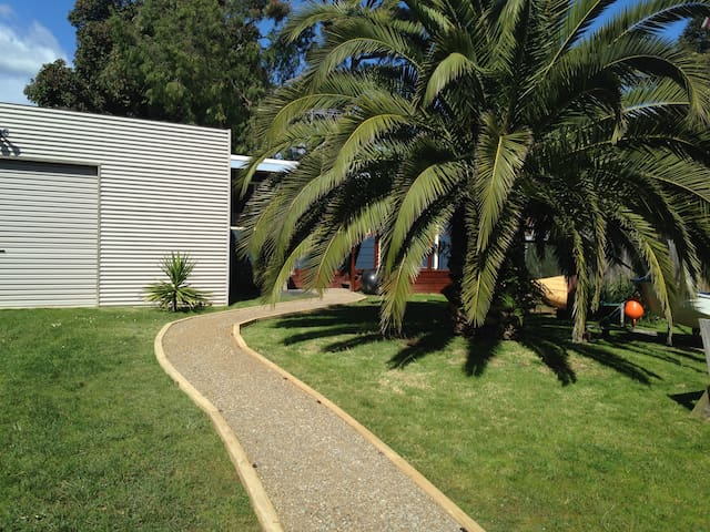 Backyard and path to bungalow
