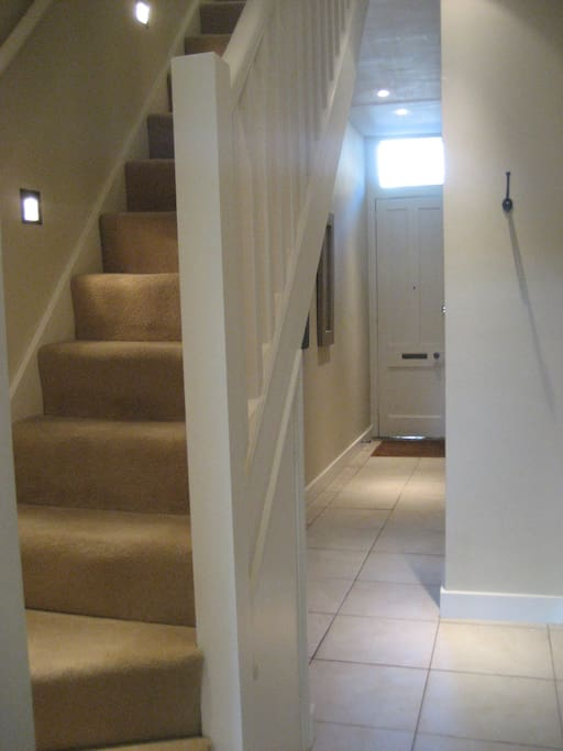 Own entrance and hallway leads to galley kitchen and stairs up to bedrooms, bathroom and living room.