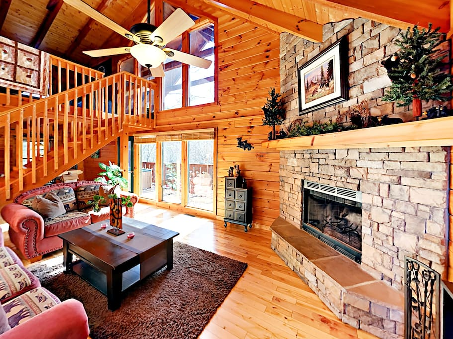 Enjoy the cozy ambiance of the crackling wood-burning fireplace and floor-to-ceiling hearth.