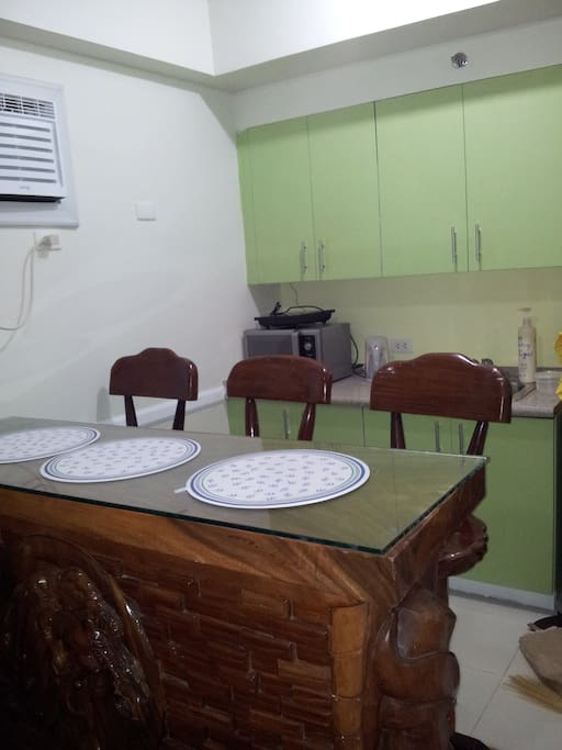 bar counter tjat serves ad dinning table