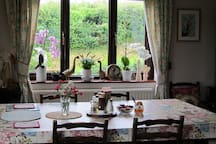 Refreshed and reinvigorated, stroll down to the light, bright and airy dining room...