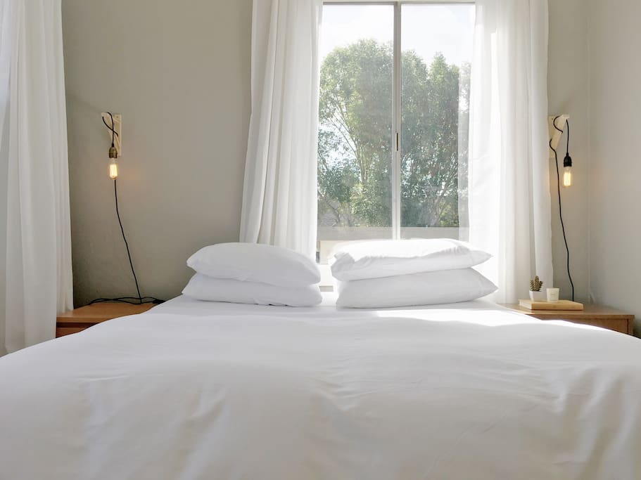 Crisp, clean white linens and lots of pillows to remind you to relax & sleep easy!