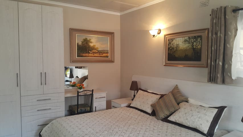 Comfortable bed & fitted cupboards