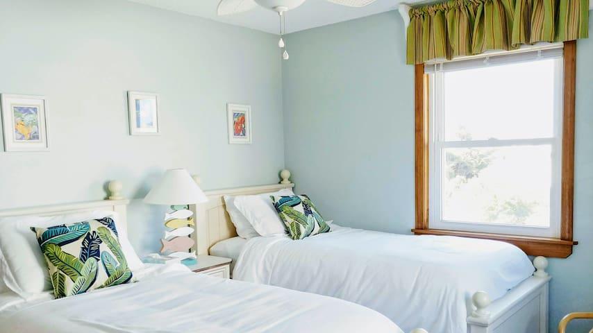 Second level twin bedroom.