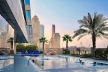 Pool with the view to the towers and Dubai-Ain