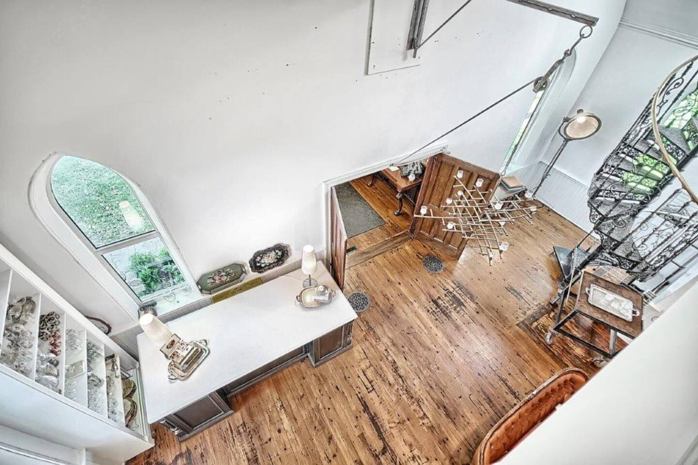 Main floor and spiral staircase below open to above.  (view from Loft Bedroom)