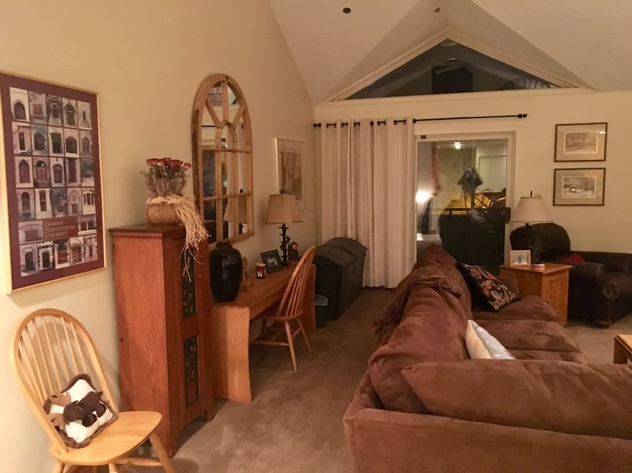 Family room with cathedral ceiling, work station...