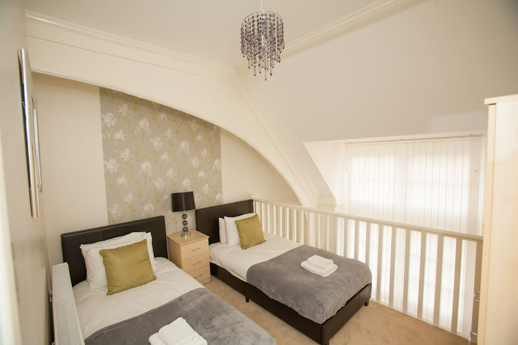 Twin mezzanine bedroom, with bedside cabinets and wardrobe