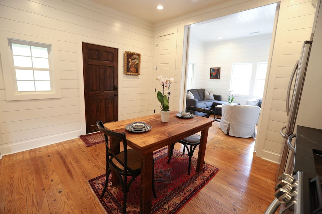 Living area and kitchen flow to make a great space when the sliding barn doors are left open which can be closed to turn into private 2nd bedroom.
