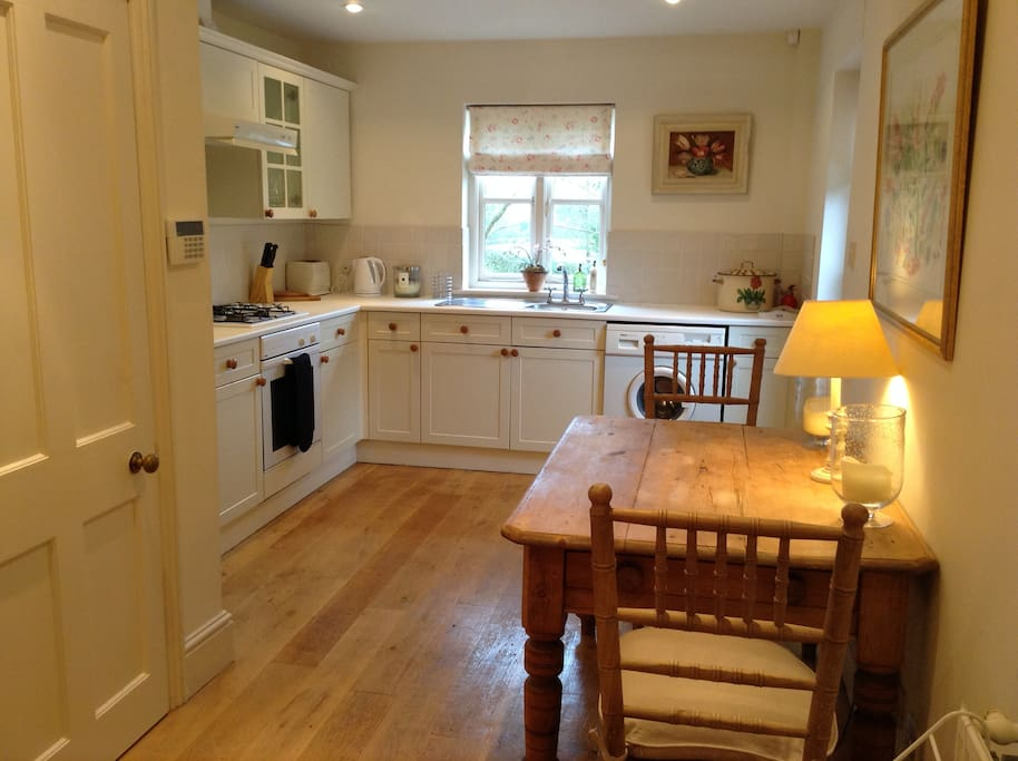 Well equipped kitchen with seating for two people