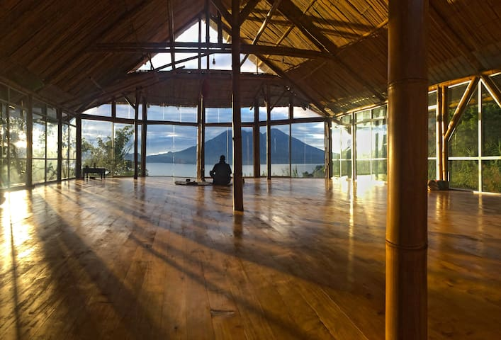 Amazing sunrise from our bamboo Yoga shala with lake and volcano view