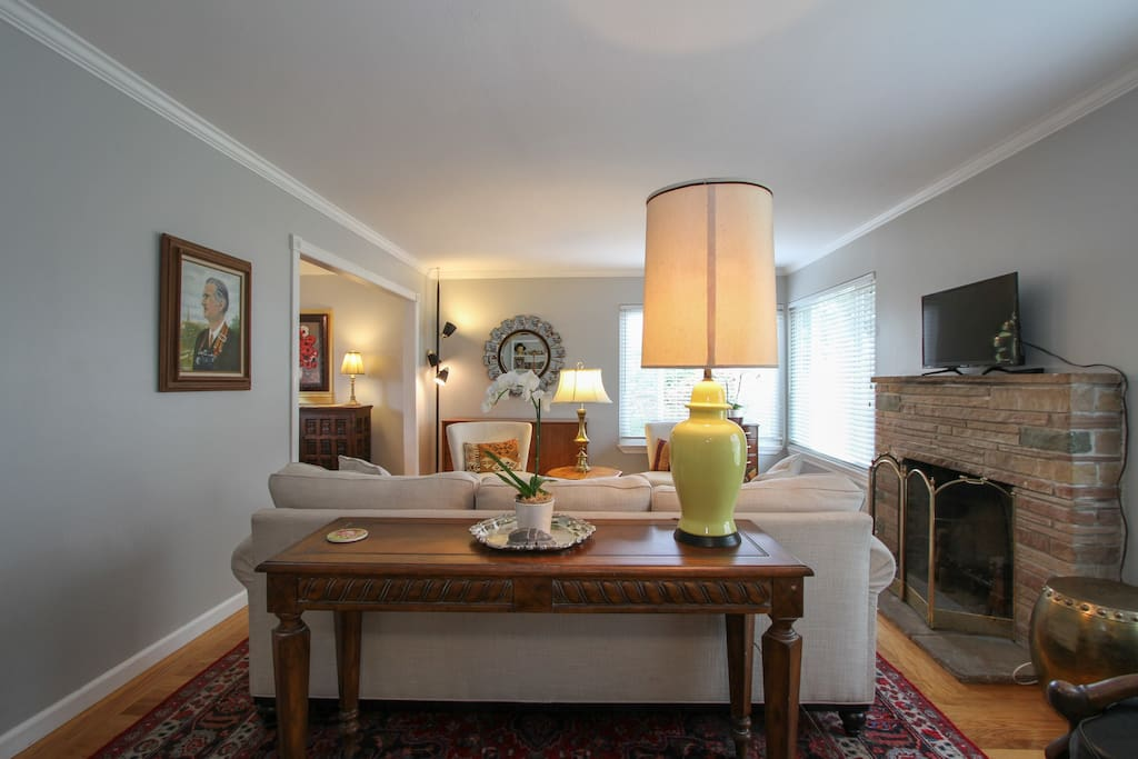 Mid century modern lamps and original artwork throughout