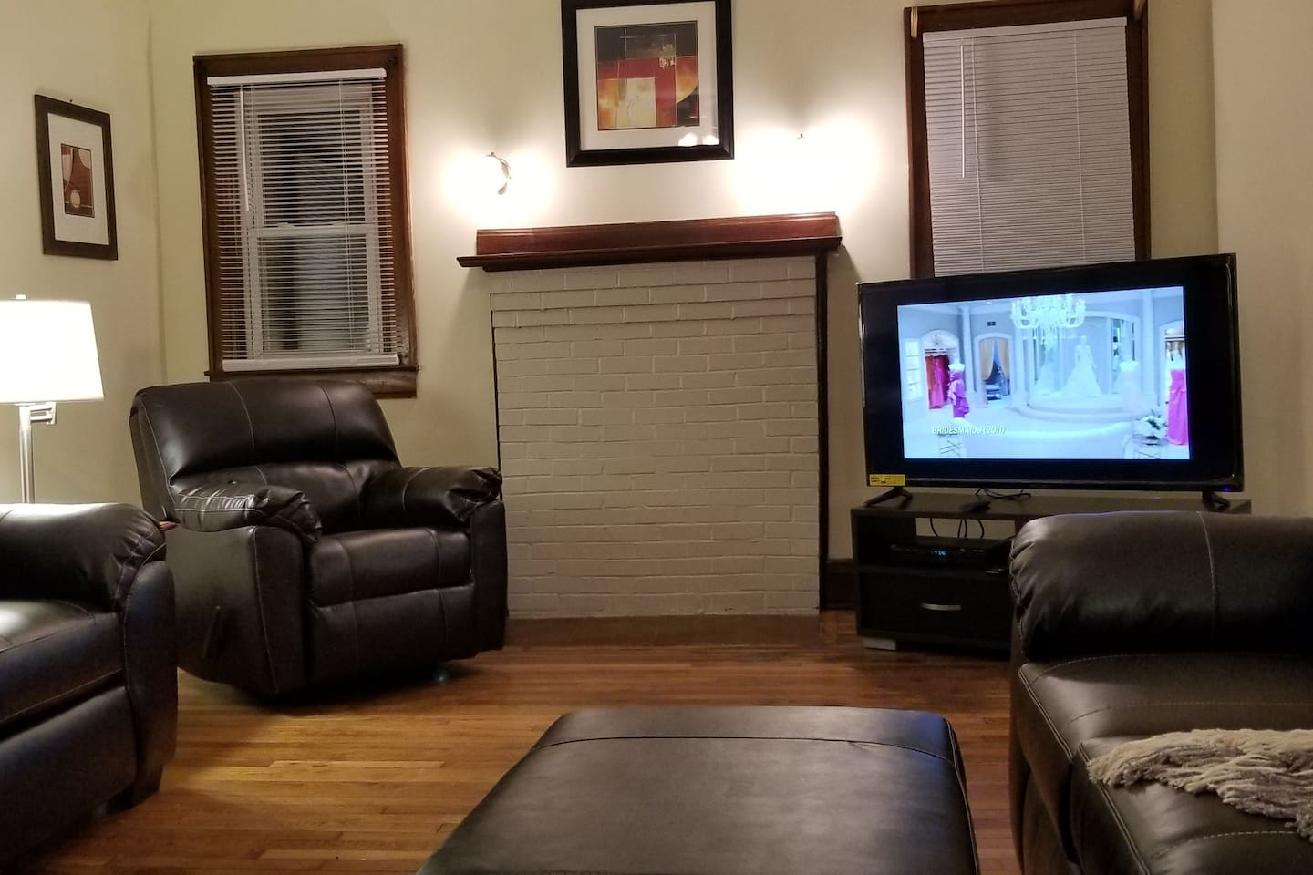 Living room with new leather couches and a 55in smart tv