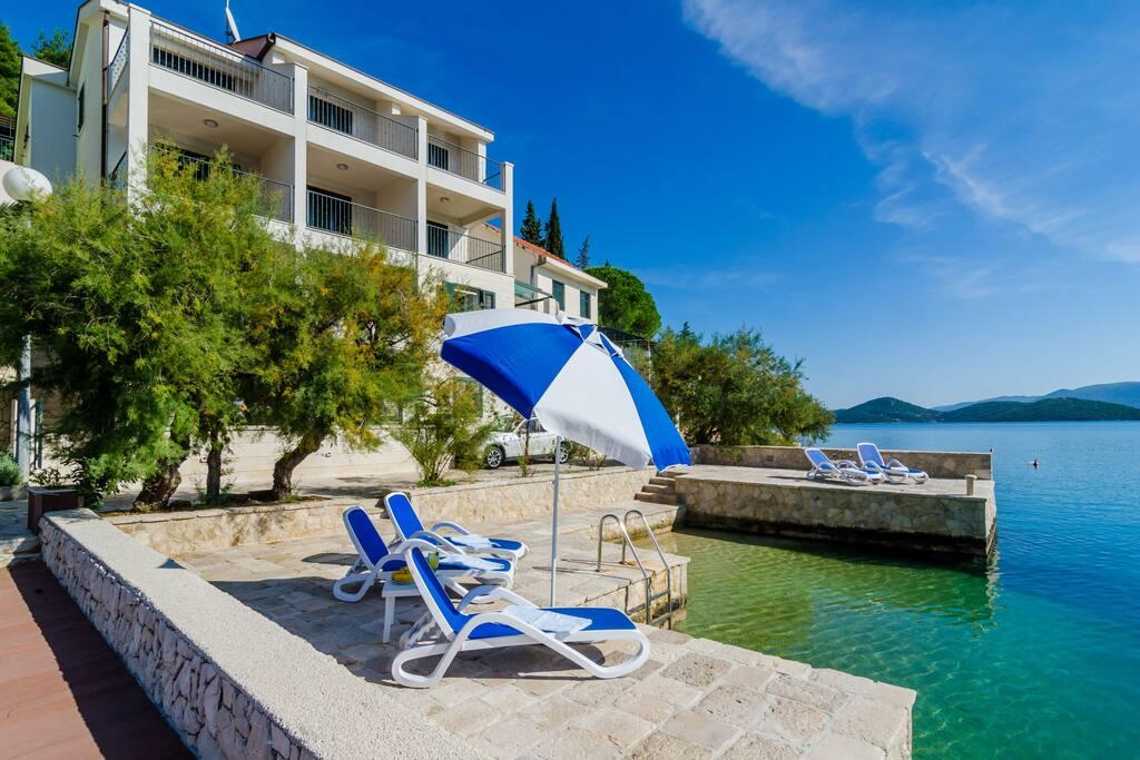 Villa Regina Maris, private deck with shower and sunbeds.