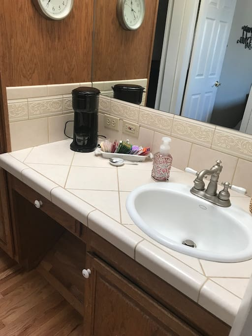 Bathroom with coffee maker.