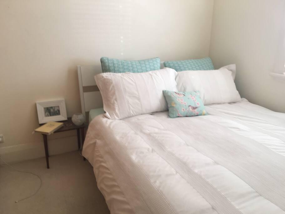 Medium sized bedroom with queen bed