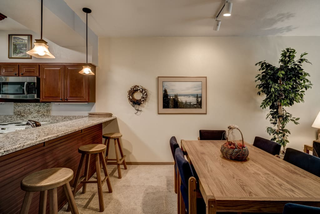 The bar offers seating for 3 in the kitchen