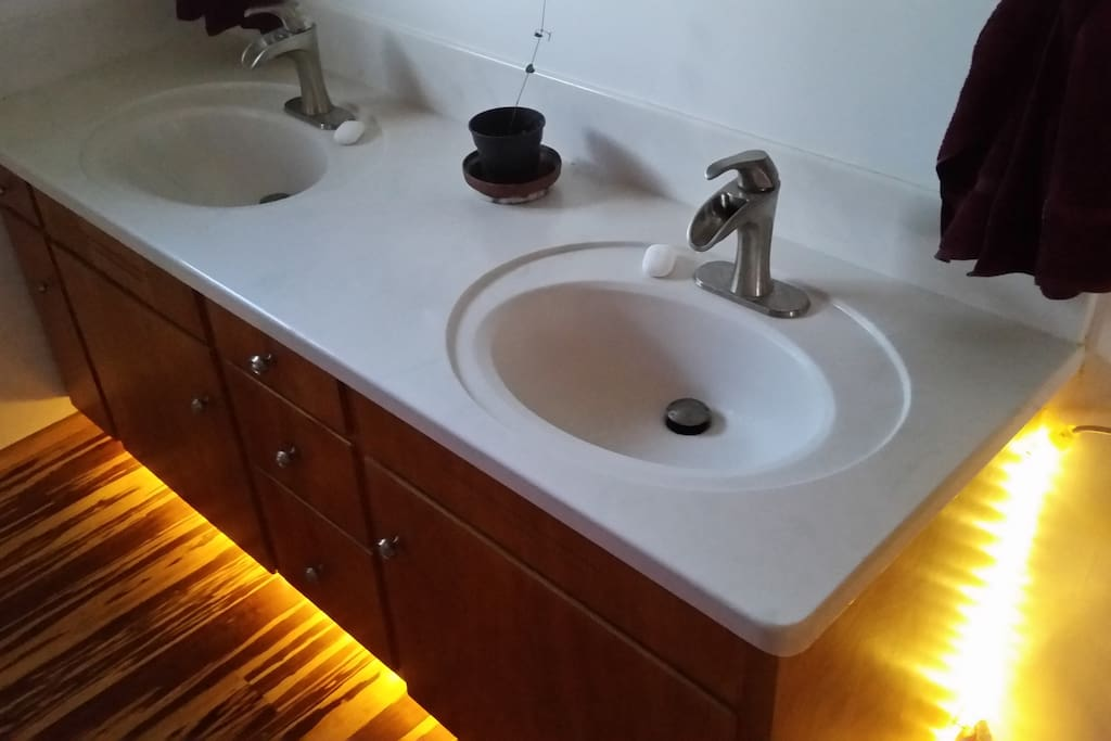 Shared bathroom with under counter safety light.