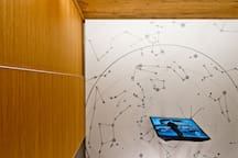 Ceiling with stars. There are lights so you can stargaze without leaving the flat.