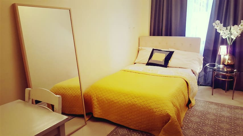 Yellow room in Kazanchis Self Catering Apartment