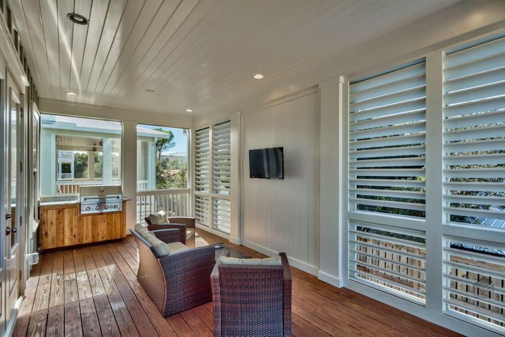 The outdoor deck has lots of lounging spots, not to mention an outdoor TV.