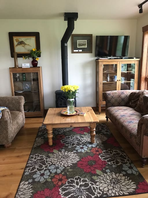 Cozy up in the living room with a good book or a family game. Huge picture glass windows over look Farewell Mountain. Cable T.V and WiFi are included for your use.