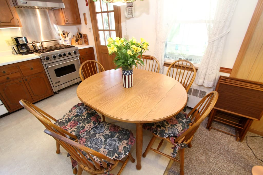 Charming wooden dining set for six in the kitchen