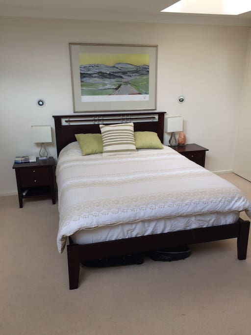 Large master bedroom with ensuite and air-conditioning unit